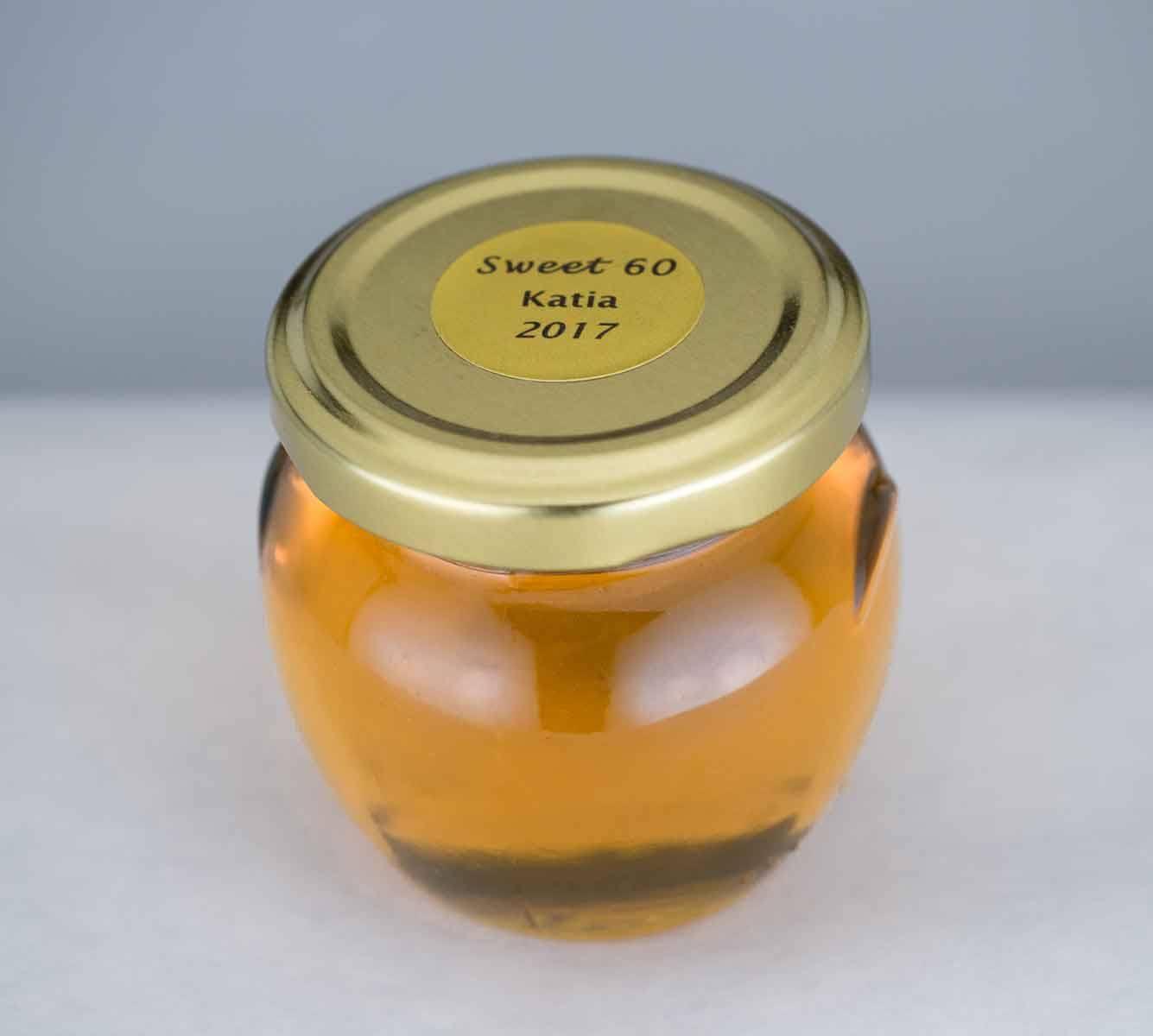 A 4oz. Honey Pot honey favor with custom round label